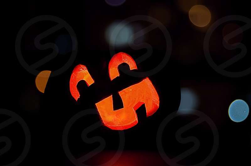 A Halloween jack-o-lantern at night. photo