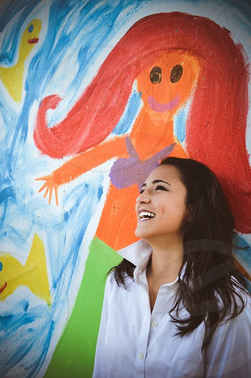 Happy girl and happy fun graffiti  photo