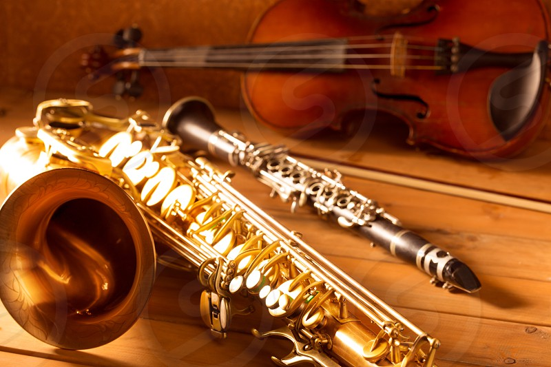 Classic music Sax tenor saxophone violin and clarinet in vintage wood background photo