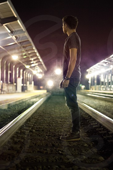Train symmetry railroad composition night lights station path shallow depth-of-field portrait photo