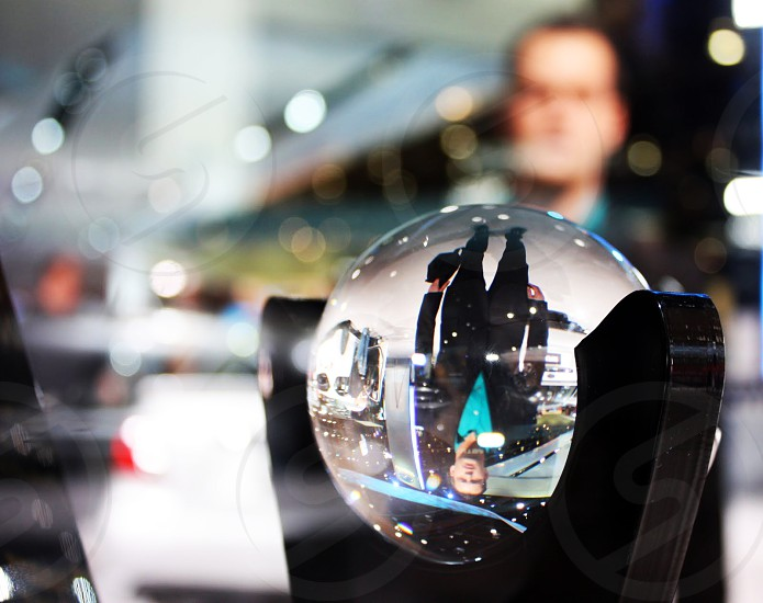 Reflection of a man in a crystal ball photo