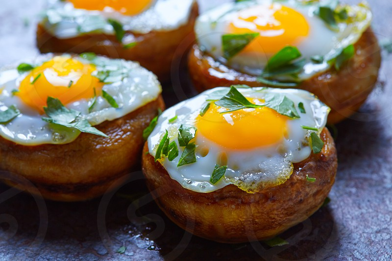 Tapas mushrooms with quail eggs from Spain pinchos pintxos photo