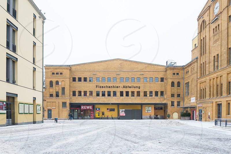 Group of historical building calls Palais in der Kulturbrauerei inside Prenzlauer Berg Neighborhood in Berlin Germany photo