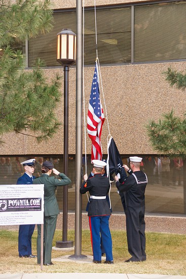 Prisoner of war flag ceremony showing all branches of military photo