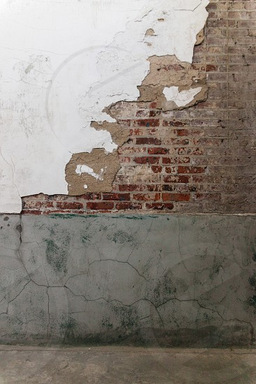 Old brick wall in an abandoned building. photo
