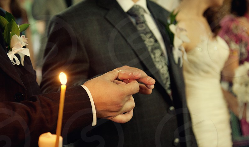 Wedding ring a groom hand photo