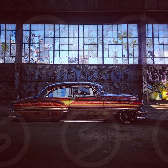 artistic retro car design in warehouse photo