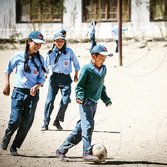 Football soccer children playing playing football school school children football field playing children  photo