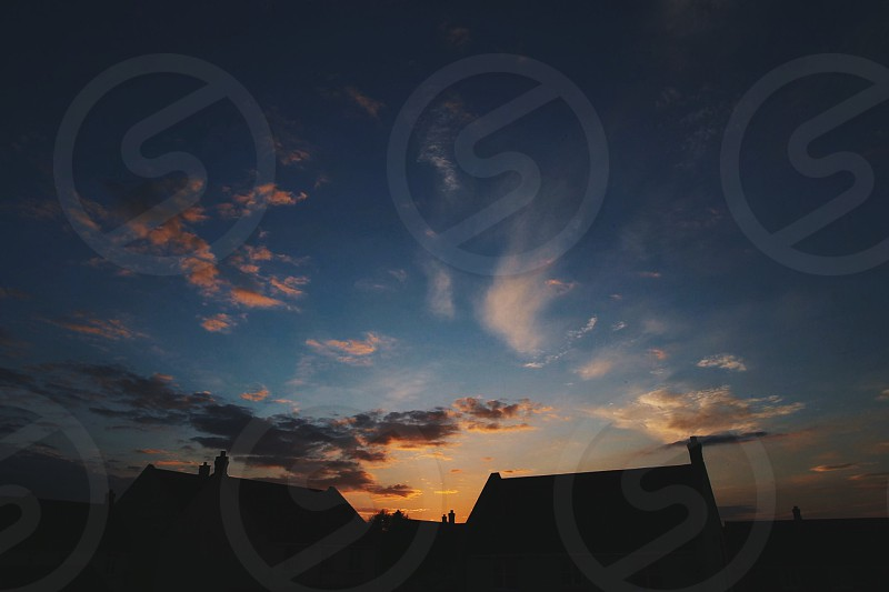 Sunset town houses Sky night clouds beauty photo