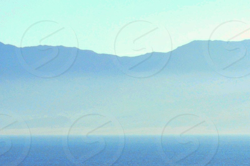 Misty morning over the sea. photo