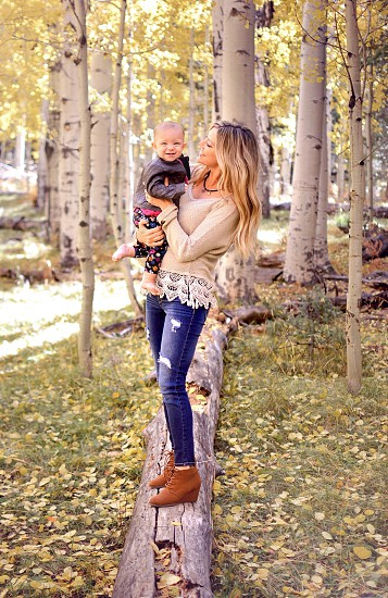 Baby and mom in an autumn forest  photo