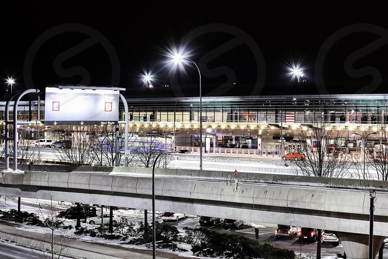airportnightlong exposurelong-exposurecitywinterbrightcarsroadstreetBoston photo