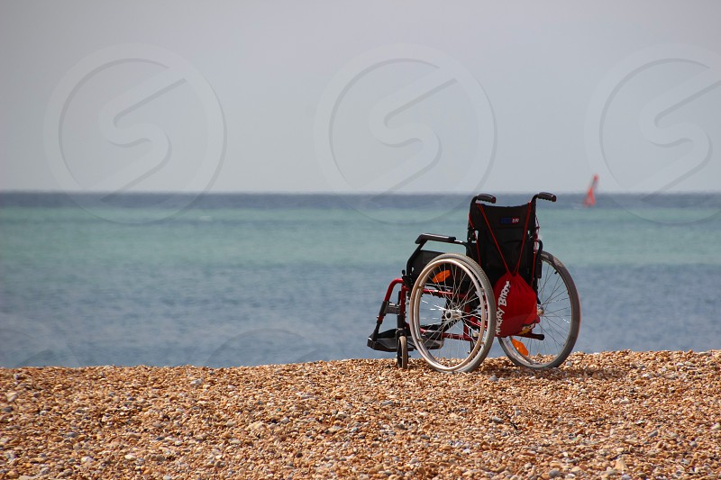 Wheelchair on beach Hastings photo
