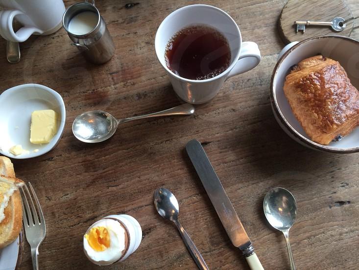 Breakfast scene with egg tea rustic table. photo