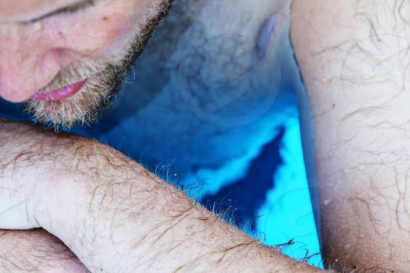 Skin deep  closeup wet  water top view head arm hair face bearded pores structure swimming pool photo