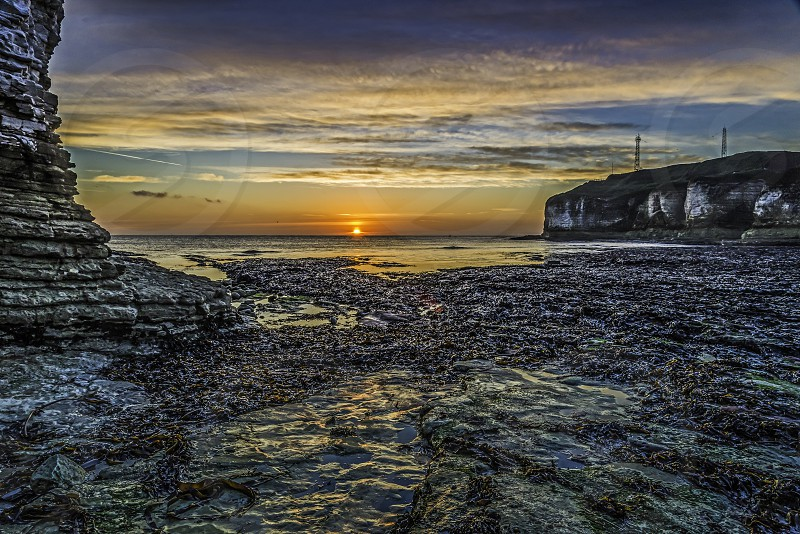 Sunrise over Selwicks Bay YorkshireEngland photo
