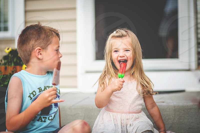 popsicles summer fun children front steps warm weather girl boy fun photo