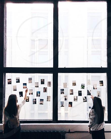 Two girls holding photos photo