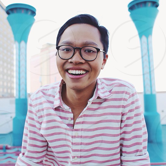 person wearing eyeglasses smiling photo
