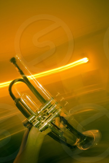 gold-colored and clear wind musical instrument photo