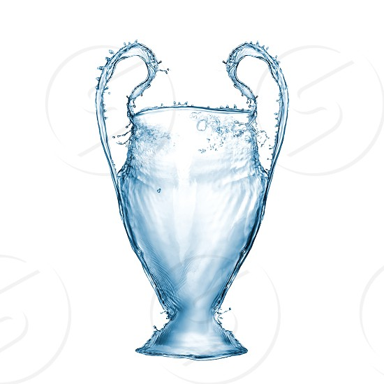 Blue cup made from water splashes on a white background. Cup as a symbol or emblem of the UEFA Champions League photo