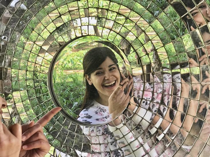 Mirror mirror  reflection  face  girl  woman  millenial  laugh  cAndid  garden  photo