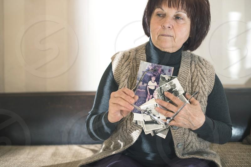 Senior woman watching old photos. Sadness photo