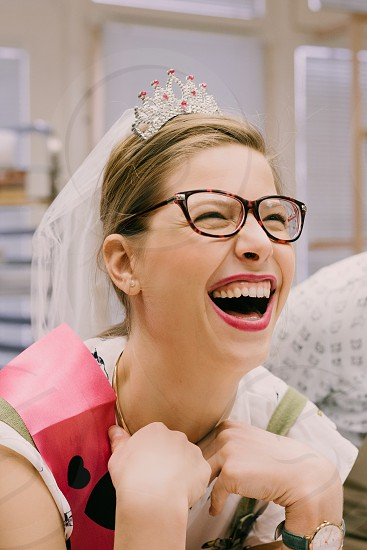 Future wife enjoying her bachelorette party to the fullest laughing hard.  photo