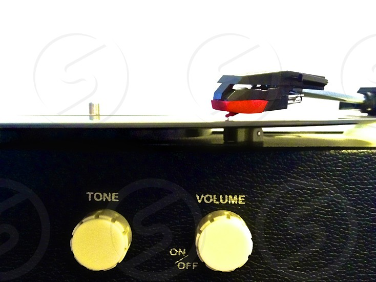 record player needle and volume knob in profile photo