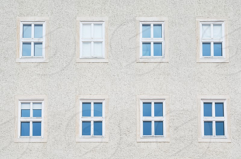 Eight Symmetrical Windows on the Building Closeup photo