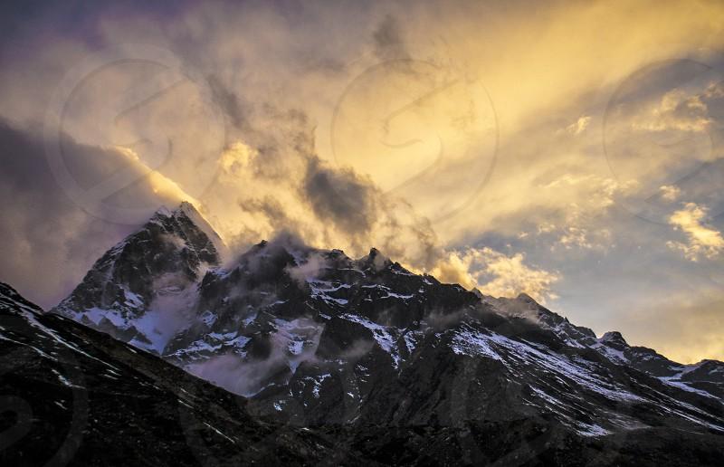 black white snow mountain producing smoke during daytime photo