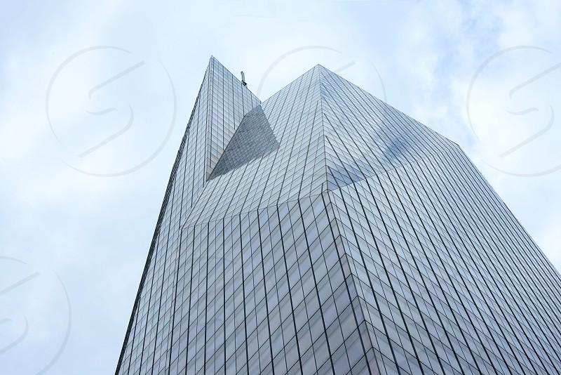 grey glass paneled building under cloudy sky photo