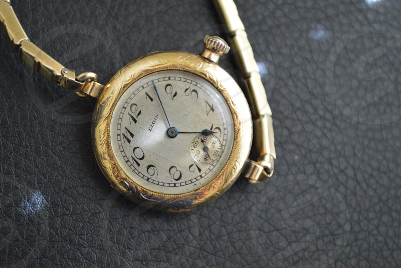 elgin silver and gold analog watch photo