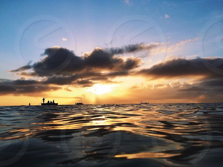 sunrise in Zanzibar island. Fishermen starting their day. photo