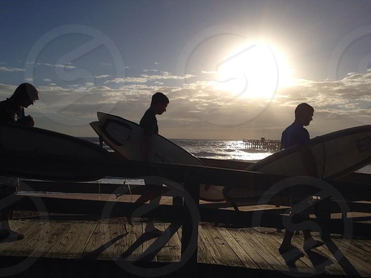 Sunrise surfers Flagler Beach Pier FL photo