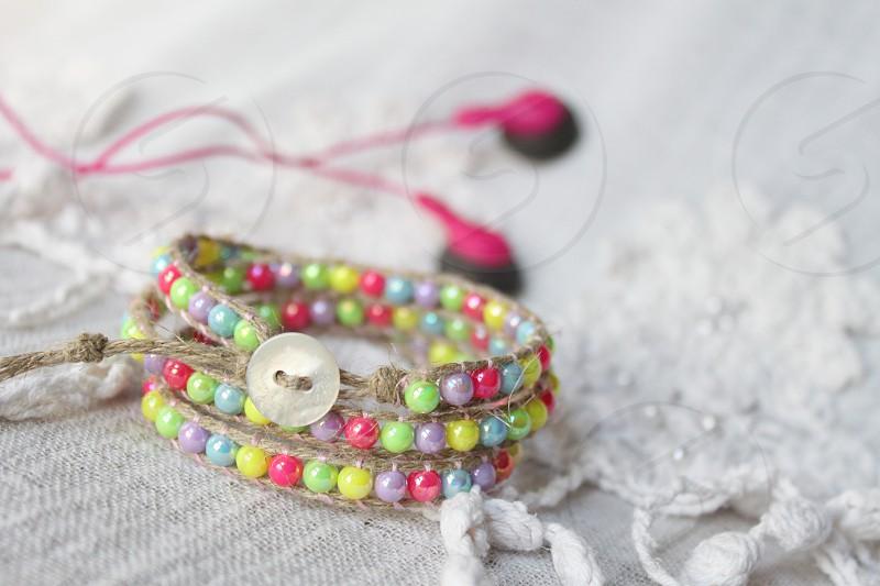 brown beaded bracelet on white textile photo