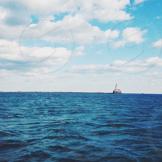 ocean view with cumulus cloud photo