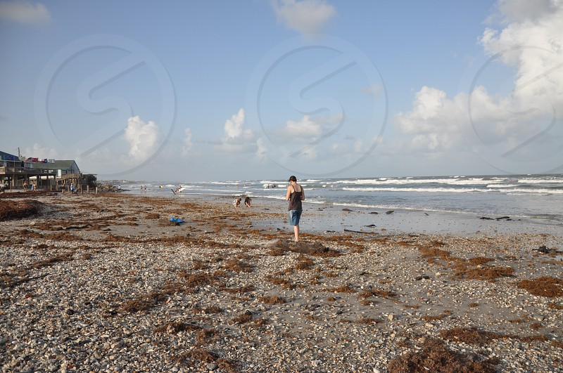 Walking on the beach surf side Texas  photo