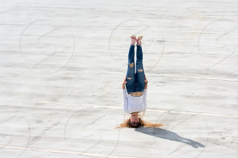 Young woman dancing breakdance on the street. photo