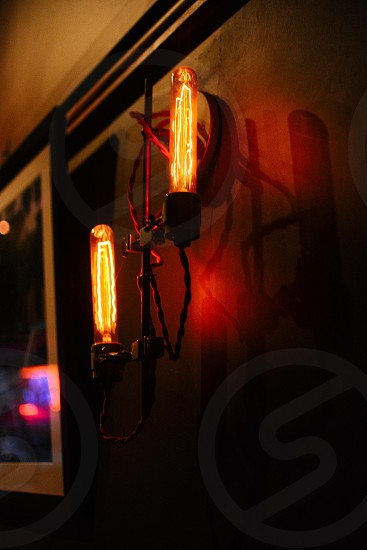 red 2 led ligh near black and white wall decor inside of dark room photo