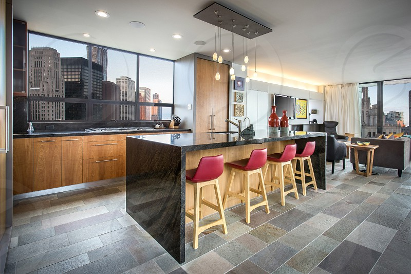 Modern kitchen in downtown high-rise.  (TV glare reduced) photo