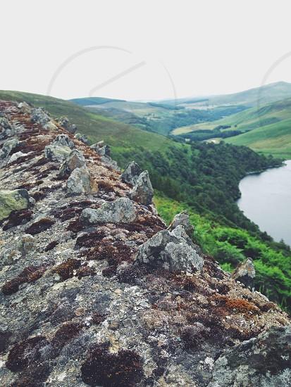 rocky mountain beside water photo