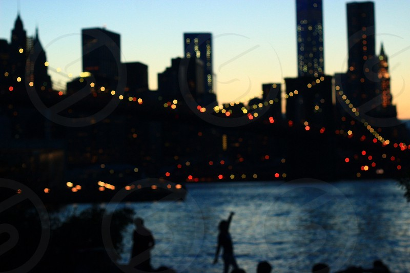 Summer nights in Brooklyn. Silhouette cast against the skyline  photo