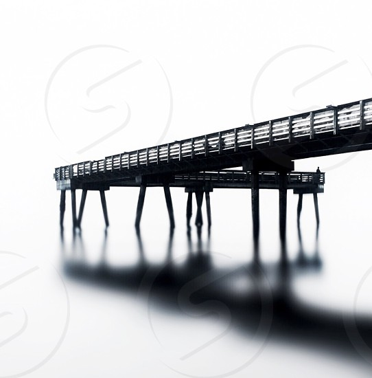 brown wooden bridge in black and white photo