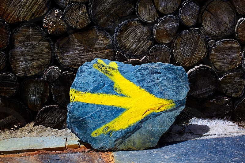 O Cebreiro by the way of Saint James in Galicia yellow arrow sign Spain photo