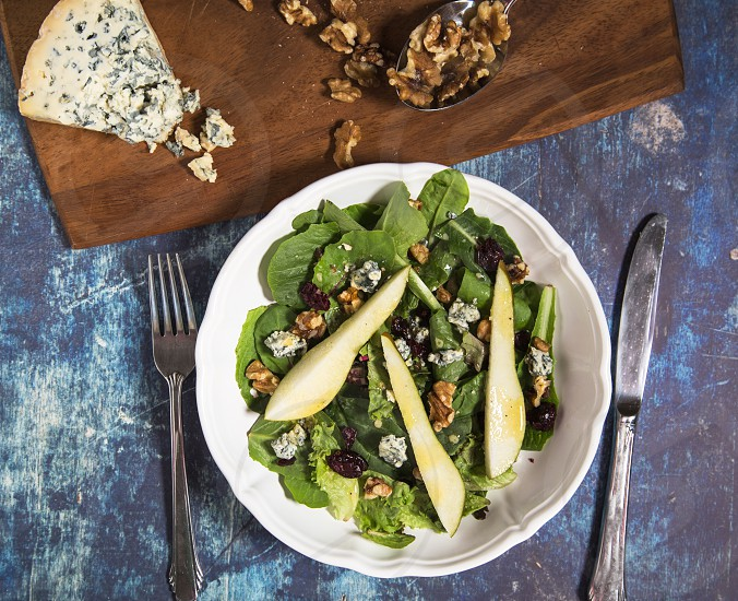 Composed salad with pears blue cheese cranberries and walnuts photo