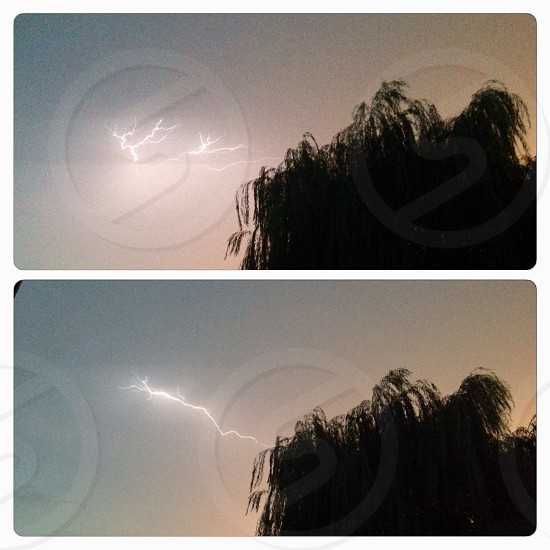 Lightning in the sky on a stormy day photo
