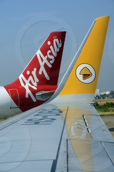 a airplane of air asia at the airport Don Muang  in the city of Bangkok in Thailand in Southeastasia. photo