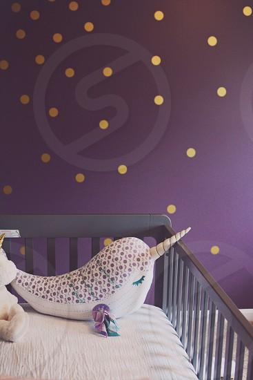 nursery decor narwhal crib stuffed animal magical purple fantasy interior bedroom gold pattern photo