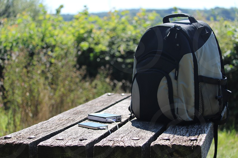 Phone power bank mobile solar charge charging mobile cell portable outdoor trip bench table picnic wood bag back pack rucksack photo